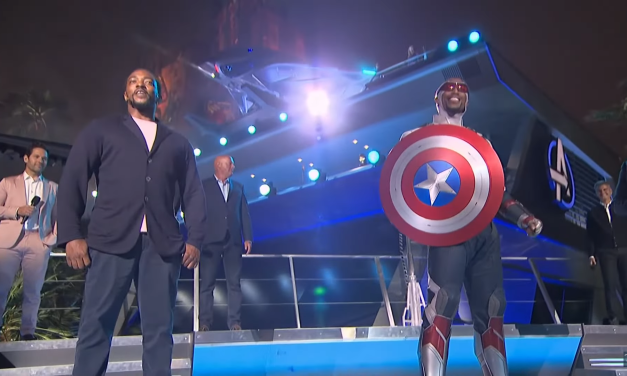 Anthony Mackie hands Sam Wilson / Captain America his shield at AVENGERS CAMPUS grand opening ceremony